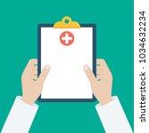 clipboard in his hand doctor.... | Shutterstock .eps vector #1034632234