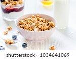 fitness breakfast with muesli ... | Shutterstock . vector #1034641069