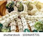 thai wedding flower garland... | Shutterstock . vector #1034645731