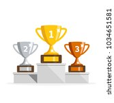 winners podium with cups.... | Shutterstock .eps vector #1034651581