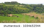 hills of tuscany in green... | Shutterstock . vector #1034652544