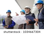 instructor with young people in ... | Shutterstock . vector #1034667304