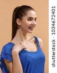 beautiful female three quarters ... | Shutterstock . vector #1034672401