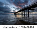 Fishing Pier At Sunrise In...