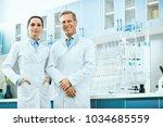 scientists in laboratory.... | Shutterstock . vector #1034685559