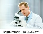 clinical test. scientist with... | Shutterstock . vector #1034689594