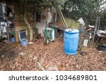 assorted rubbish in a neglected ...   Shutterstock . vector #1034689801