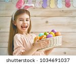 cute little child wearing bunny ... | Shutterstock . vector #1034691037