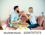 happy modern young couple... | Shutterstock . vector #1034707375