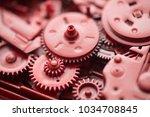 red gears and cogs macro shot ... | Shutterstock . vector #1034708845