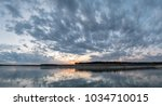 large panorama of storm clouds... | Shutterstock . vector #1034710015
