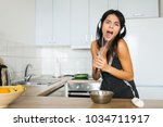 young attractive woman cooking... | Shutterstock . vector #1034711917