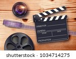 film reel  lens and movie... | Shutterstock . vector #1034714275