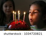 a five year old girl in the... | Shutterstock . vector #1034720821