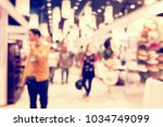 blurred image of shopping mall...   Shutterstock . vector #1034749099