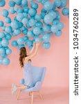 a sexy little girl in a blue...   Shutterstock . vector #1034760289