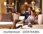 a couple of lovers watch... | Shutterstock . vector #1034764381