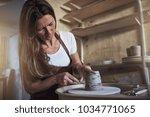 female artisan creatively...   Shutterstock . vector #1034771065