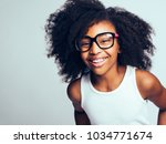 happy little african girl with... | Shutterstock . vector #1034771674