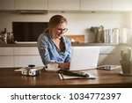 smiling young woman working... | Shutterstock . vector #1034772397