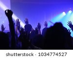 night of worship. silhouette... | Shutterstock . vector #1034774527