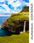 waterfall of gasadalur  a... | Shutterstock . vector #1034783425