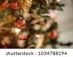 gold christmas background of de ... | Shutterstock . vector #1034788294
