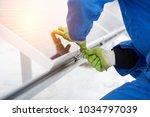 engineers installing solar... | Shutterstock . vector #1034797039