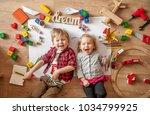 kids drawing on floor on paper. ... | Shutterstock . vector #1034799925