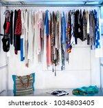 rack of  colourful  dresses....   Shutterstock . vector #1034803405