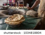 tandoori naan or roti   indian... | Shutterstock . vector #1034818804