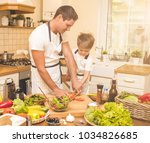 father is cooking with his son   Shutterstock . vector #1034826685