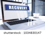 recovery text on modern laptop... | Shutterstock . vector #1034830147