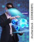 Small photo of Business, Technology, Internet and network concept. Young businessman working in virtual reality glasses sees the inscription: ASP.NET