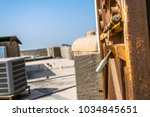 old and rusty lock hanging on... | Shutterstock . vector #1034845651
