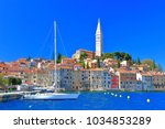 sail boat by the pier of rovinj ... | Shutterstock . vector #1034853289