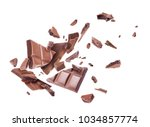 chocolate broken into pieces in ... | Shutterstock . vector #1034857774
