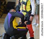 skydiver instructor helps... | Shutterstock . vector #1034862817