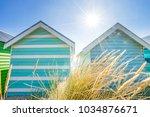brighton beach huts in... | Shutterstock . vector #1034876671