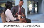 businessman and businesswoman... | Shutterstock . vector #1034880931