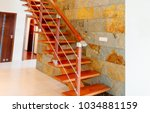 modern brown wooden stairs with ... | Shutterstock . vector #1034881159