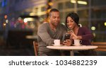 happy black couple using smart... | Shutterstock . vector #1034882239