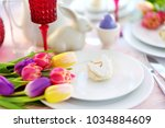 beautiful table setting with... | Shutterstock . vector #1034884609