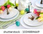 beautiful table setting with... | Shutterstock . vector #1034884669