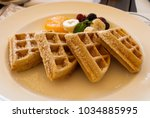 dish waffles and red fruits... | Shutterstock . vector #1034885995