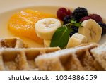 dish waffles and red fruits... | Shutterstock . vector #1034886559