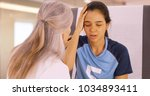 a concussed soccer player seeks ... | Shutterstock . vector #1034893411
