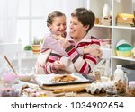 mother and daughter making... | Shutterstock . vector #1034902654