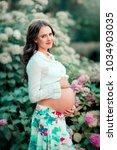 beautiful pregnant brunette... | Shutterstock . vector #1034903035