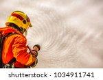 firefighter using extinguisher... | Shutterstock . vector #1034911741